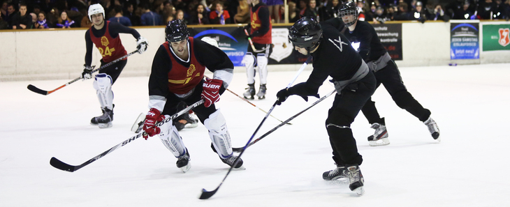 Ice hockey players dueling