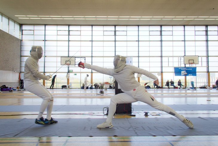 A fencer makes a successful hit